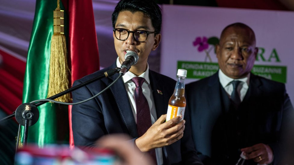 """President of Madagascar Andry Rajoelina shows a """"Covid Organics"""", a herbal medicine, which allegedly being developed against coronavirus (Covid-19), during a press conference in Antananarivo, Madagascar on April 20, 2020."""