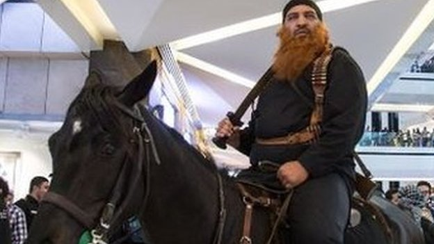 Tweeted picture of a man on a horse with a sword