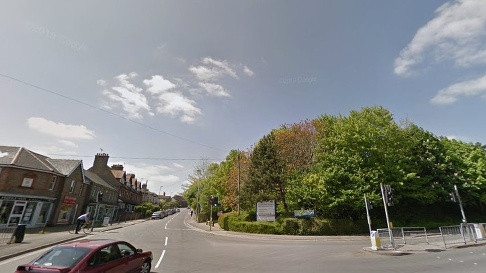 Junction of Damers Road and Williams Avenue in Dorchester lined with trees and Victorian houses