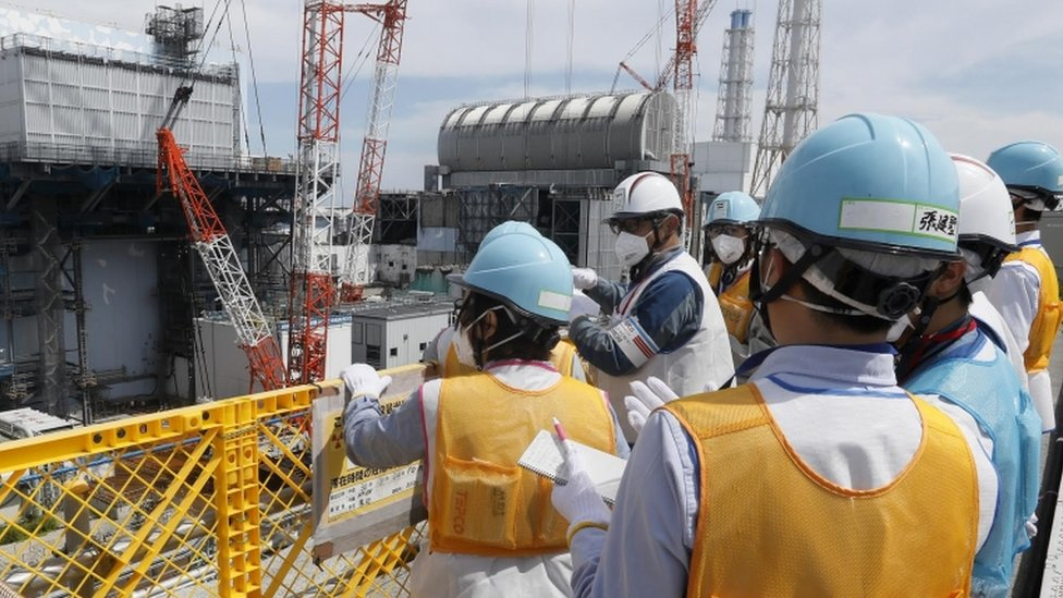Journalists pictured at the Fukushima nuclear power plant