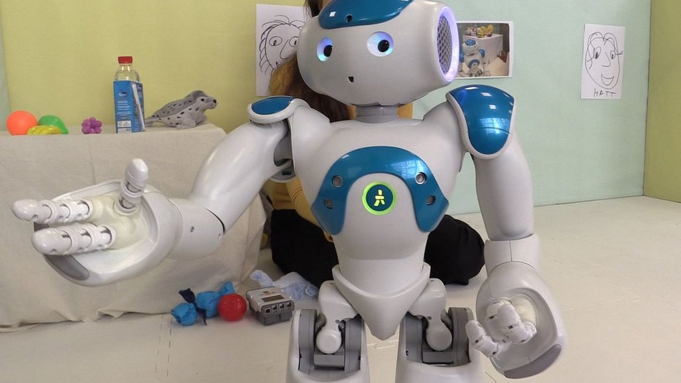 Robin the robot holds his hand out for food