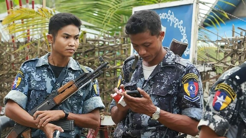 In this photograph taken on October 10, 2016, armed Myanmar border police stand guard in the village of Maungdaw, located in Rakhine State. Myanmar's army on October 10 hunted the attackers who staged deadly raids on border posts,