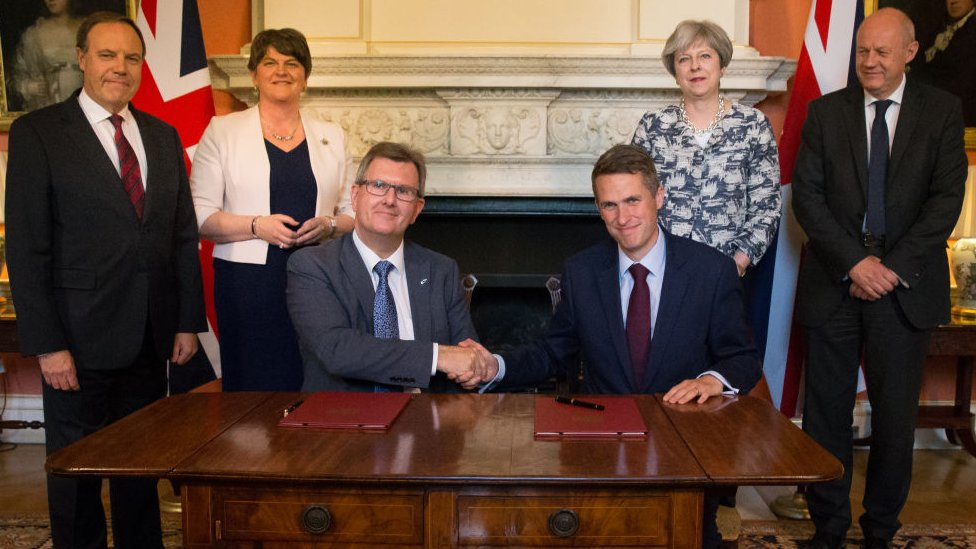 Gavin Williamson shakes hands with the DUP's Jeffrey Donaldson
