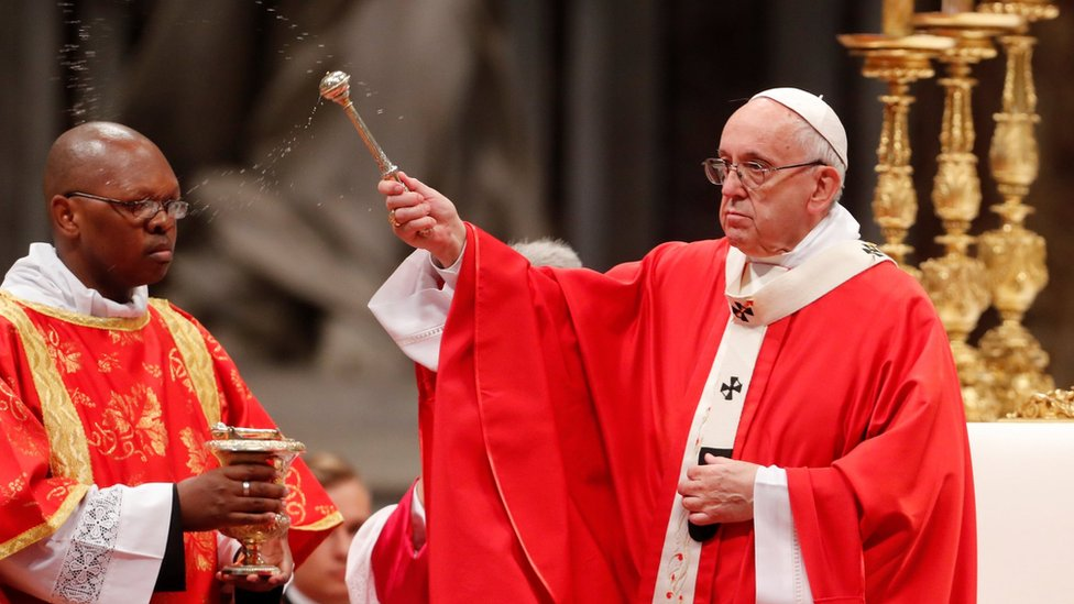"""Pope Francis sprinkles holy water during a Mass of Pentecost at Saint Peter""""s Basilica at the Vatican, May 20, 2018."""