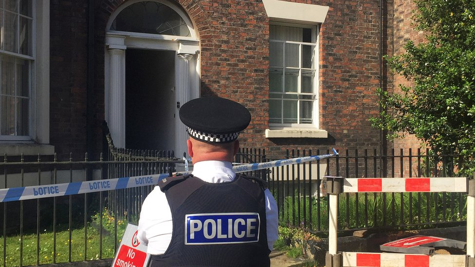 Policeman outside the house in Falkner Street
