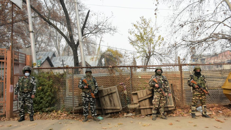 Indian forces stand alert outside a voting booth in Srinagar on 01 December 2020.