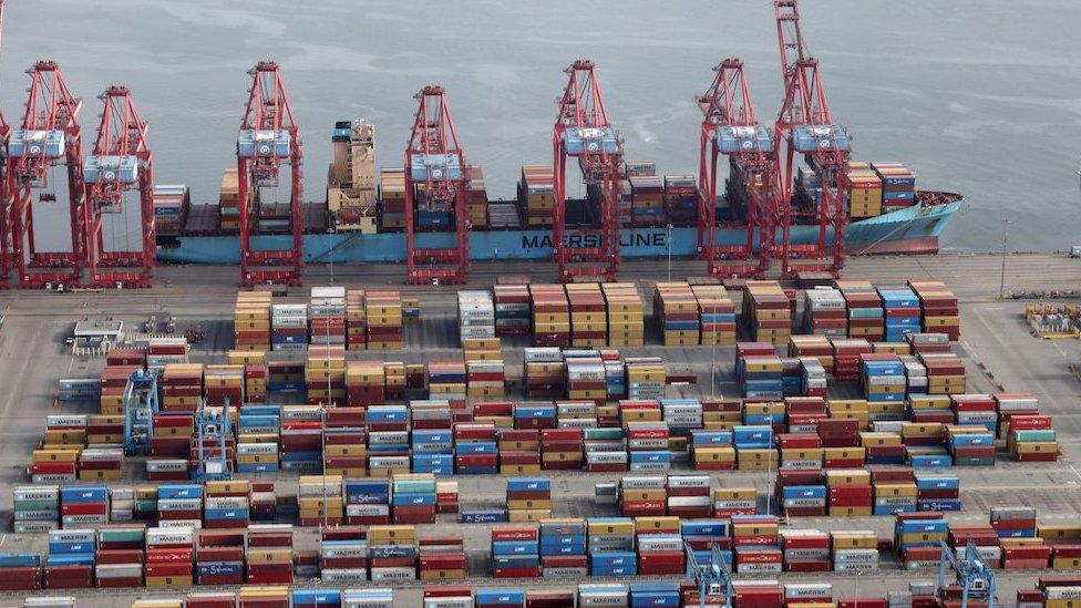Shipping containers are unloaded from a ship at a container terminal at the Port of Long Beach-Port of Los Angeles complex, April 2021