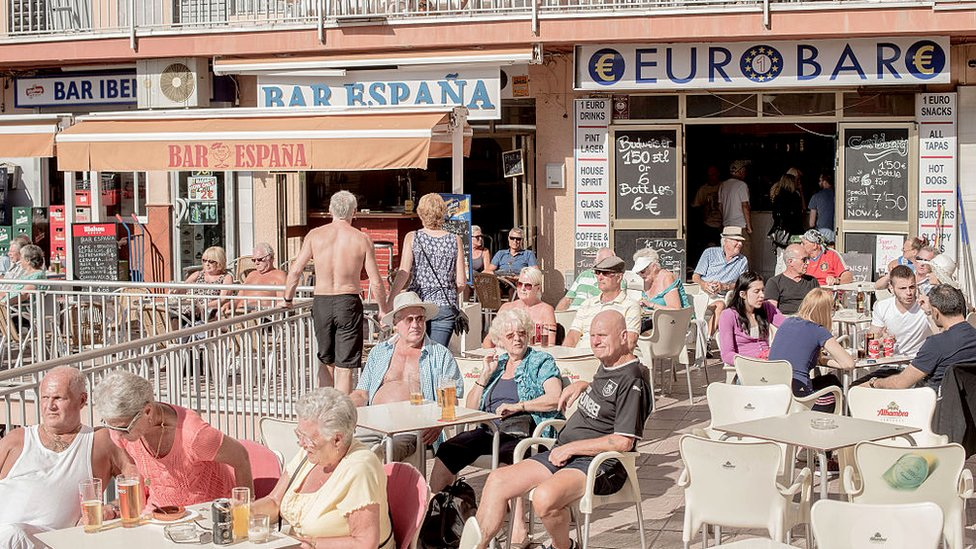 British expats and tourists at outdoor bars in Bonanza's square in Benalmadena, Spain