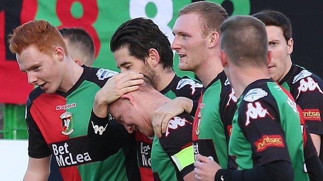 Glentoran players celebrate victory over Carrick Rangers