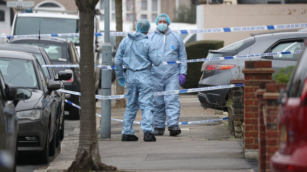 Forensic officers at the scene in Tavistock Gardens