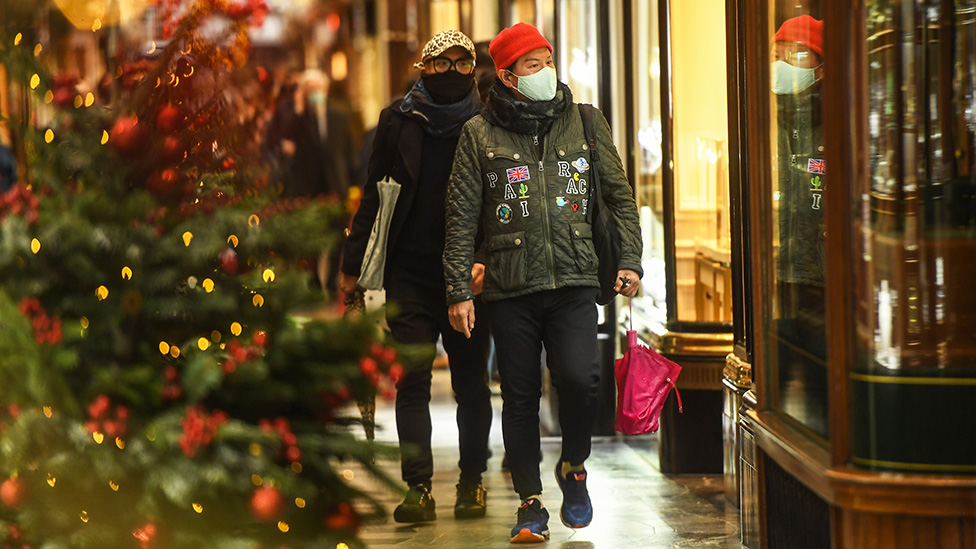 Shoppers wearing face masks are seen in London, England - 3 December 2020