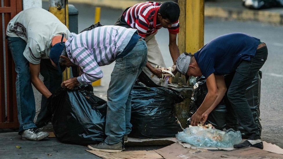 People scavenging for food in the streets of Caracas