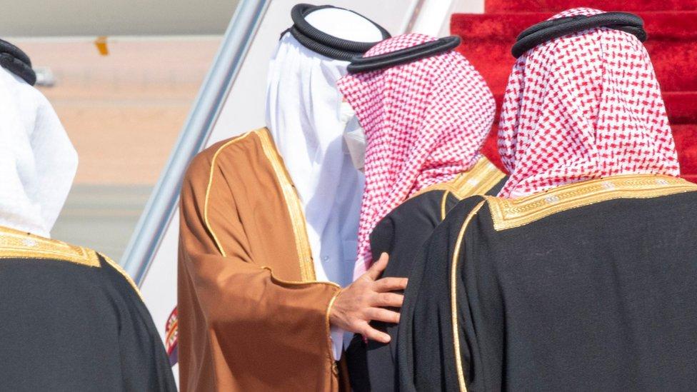 Qatar's Emir Sheikh Tamim bin Hamad Al Thani is greeted by Saudi Crown Prince Mohammed bin Salman on arrival in al-Ula, Saudi Arabia (5 January 2021)