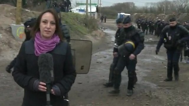Anna Holligan in the 'Jungle' as police begin to arrive