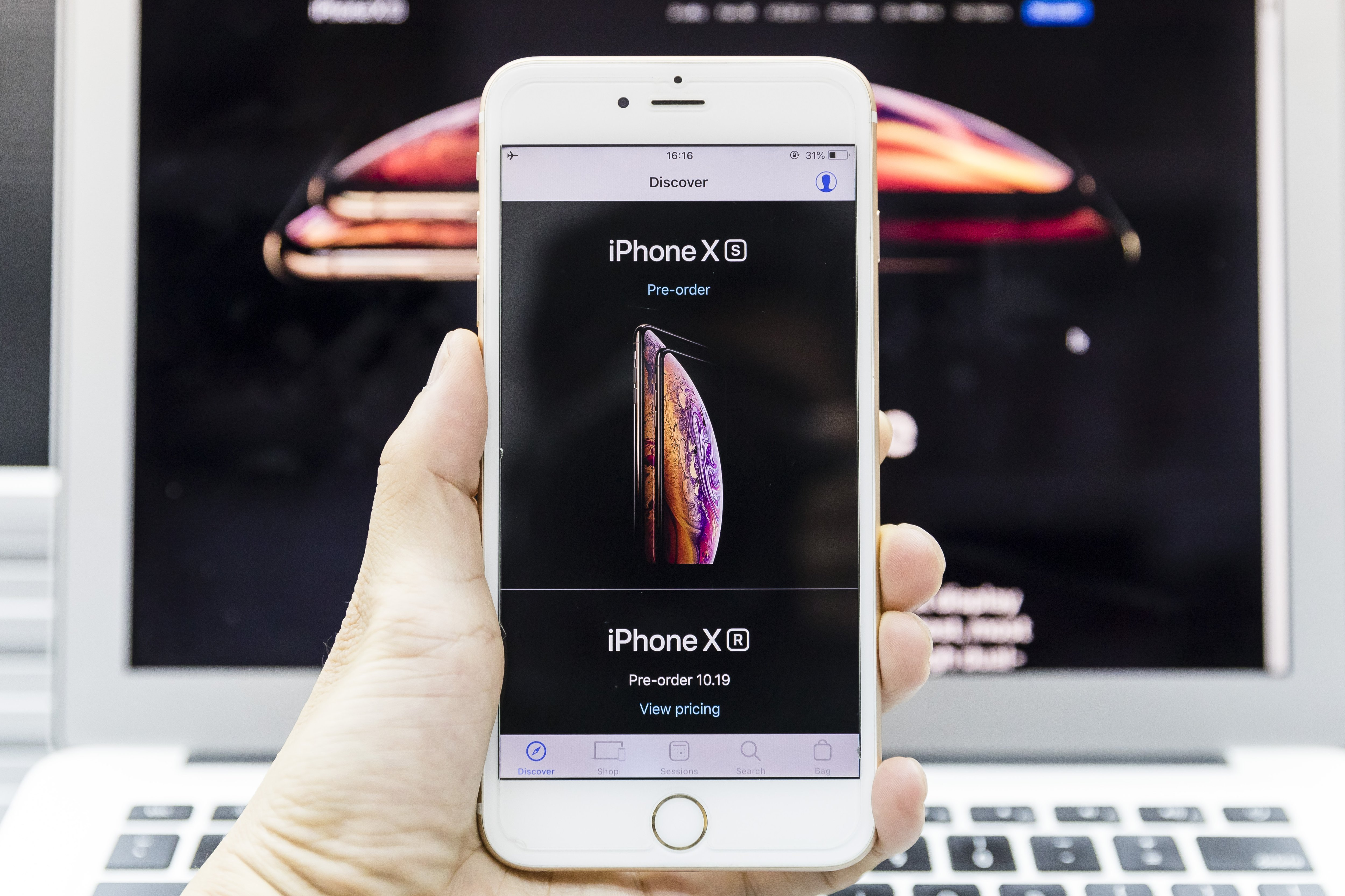 A man using an Apple Store app to pre order the new iPhone Xs on September 14 2018 in Hong Kong, Hong Kong.