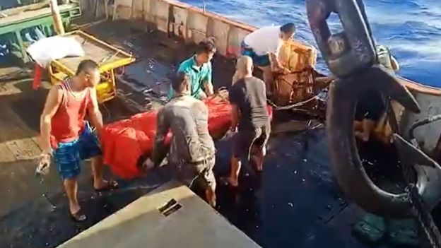 Video of body being thrown into the sea