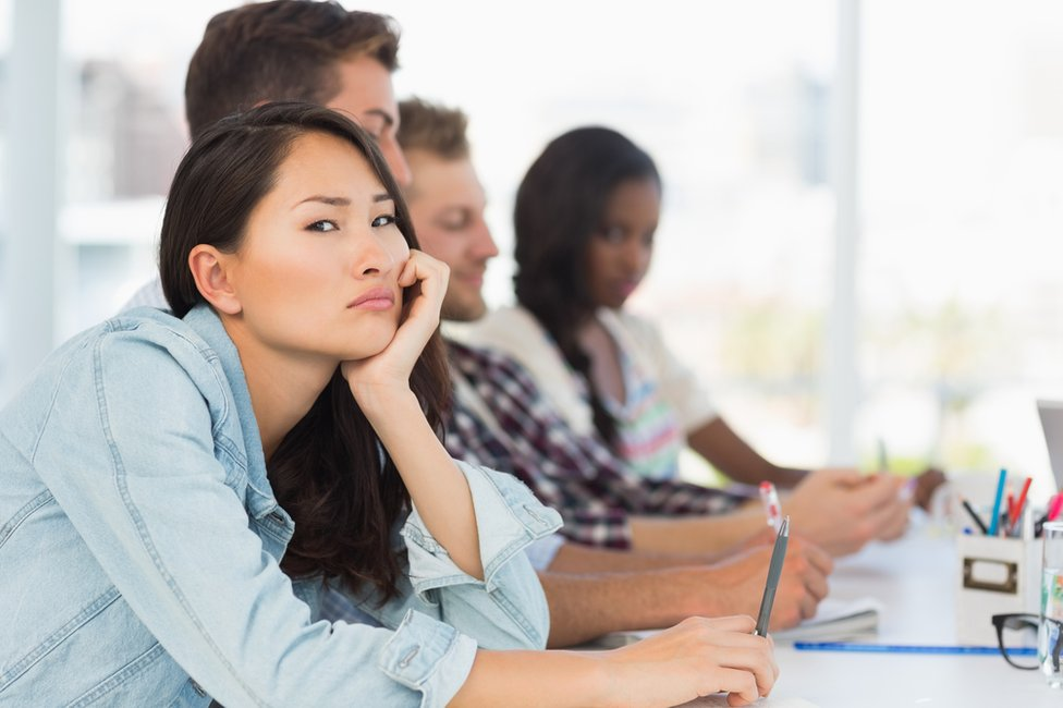 Bored woman in meeting