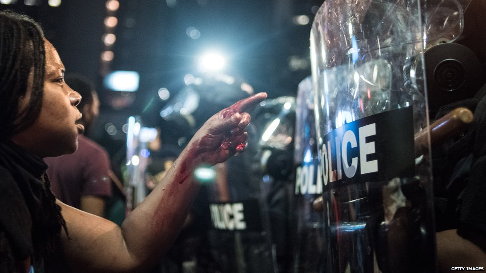 Black Lives Matter protesters shouting at police in the US