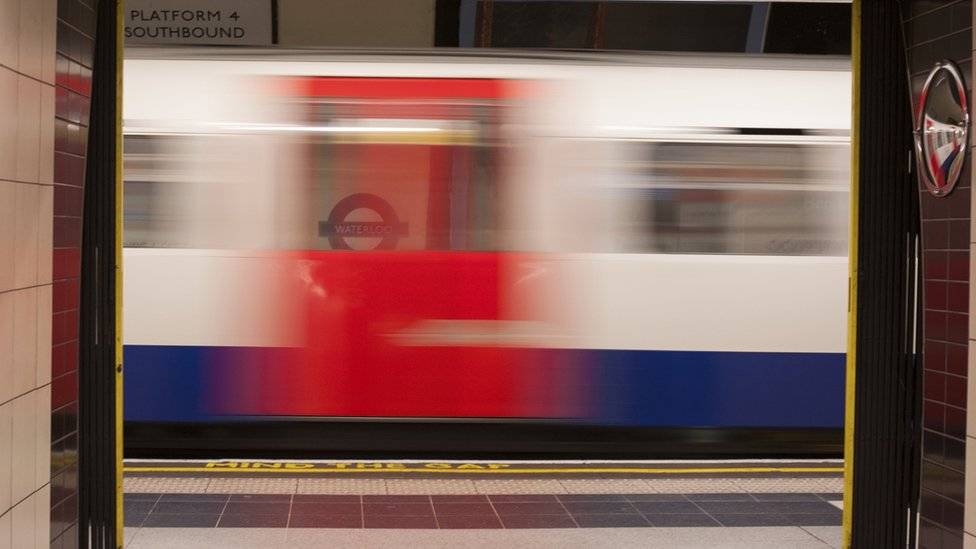 Tube carriage passing a platform