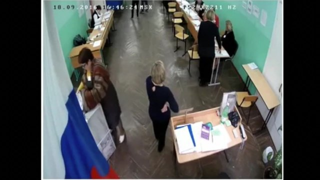 Ballot papers being stuffed into a voting box
