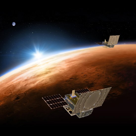 Photograph of Mars Cube One flying over Mars