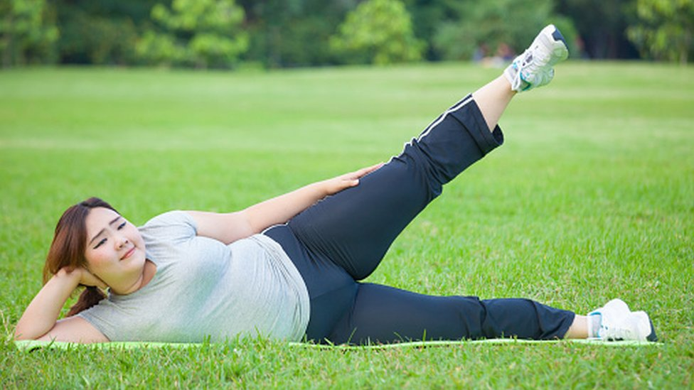 Woman exercising on the grass