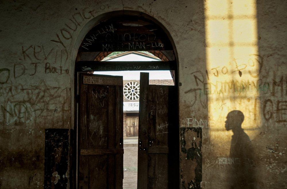 A man's shadow on a wall in Malawi