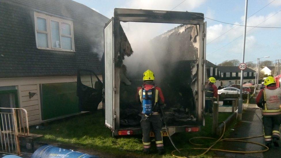 Fire officers dousing van