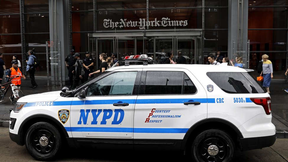 police in front of the New York Times