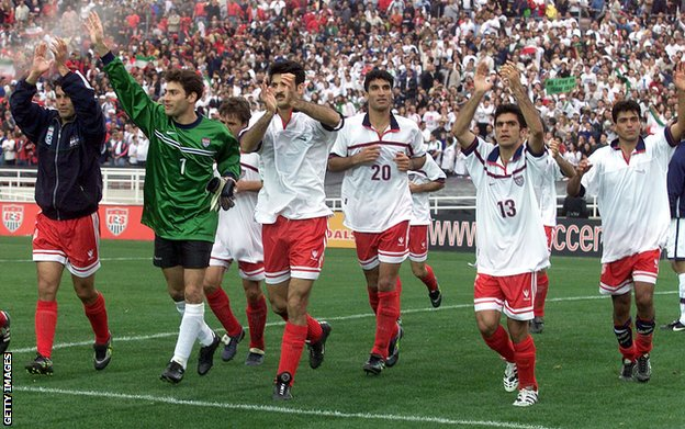 Iran players, wearing the USA shirts they have swapped, acknowledge the Rose Bowl crowd after their 1-1 draw