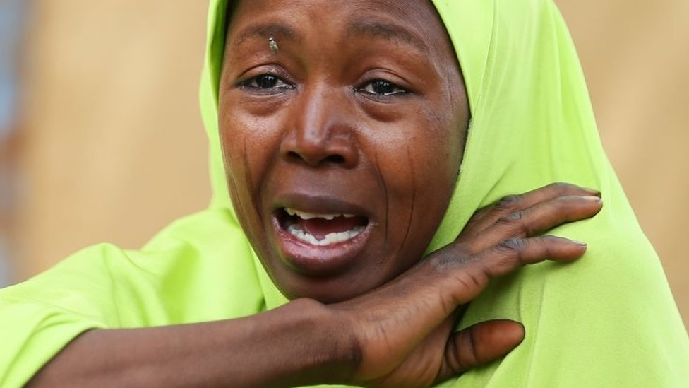 A relative of one of the missing school girls cries in Dapchi. Photo: 23 February 2018