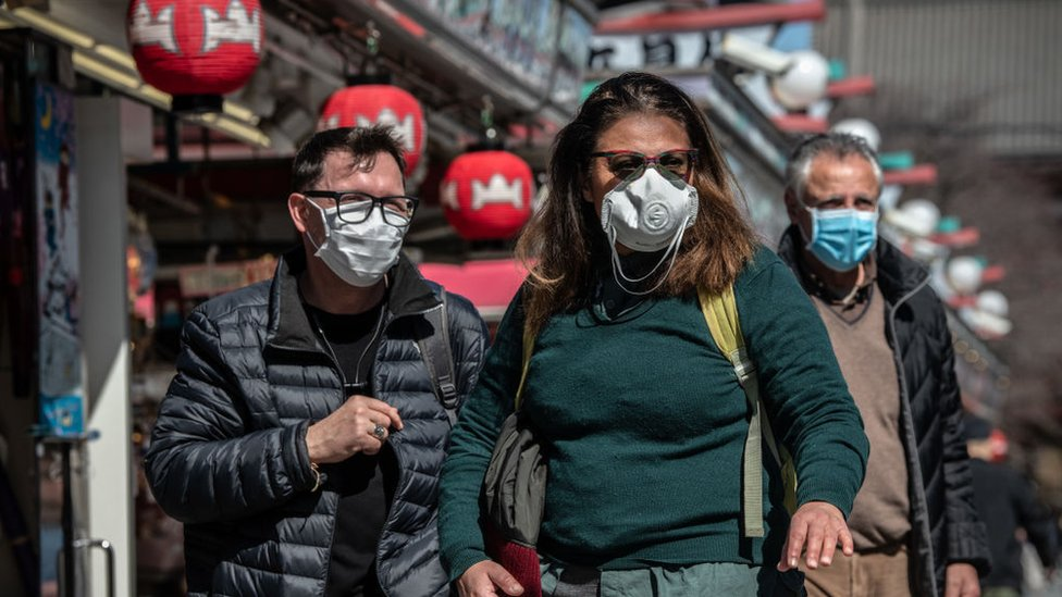 Tourists wear face masks as they visit Sensoji Temple on March 11, 2020 in Tokyo, Japan.