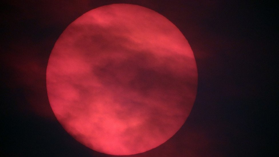 Why does the sun look red?