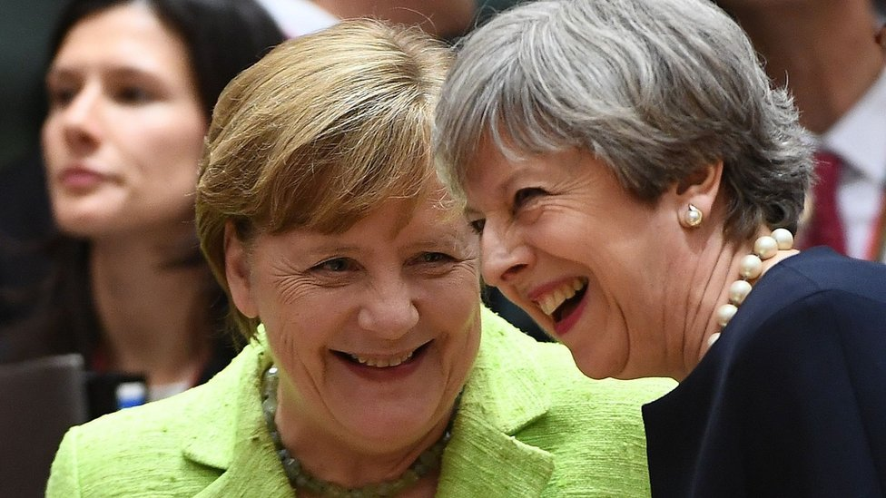 German Chancellor Angela Merkel (L) and UK Prime Minister Theresa May (R) at EU leaders summit in Brussels, on 22 June 2017