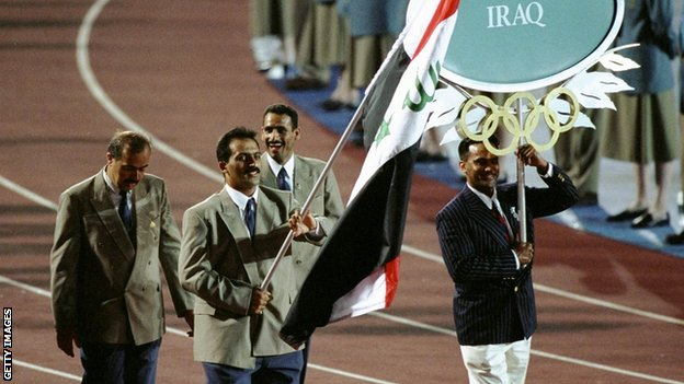 Raed Ahmed carrying the Iraq flag at the opening ceremony for Atlanta 1996