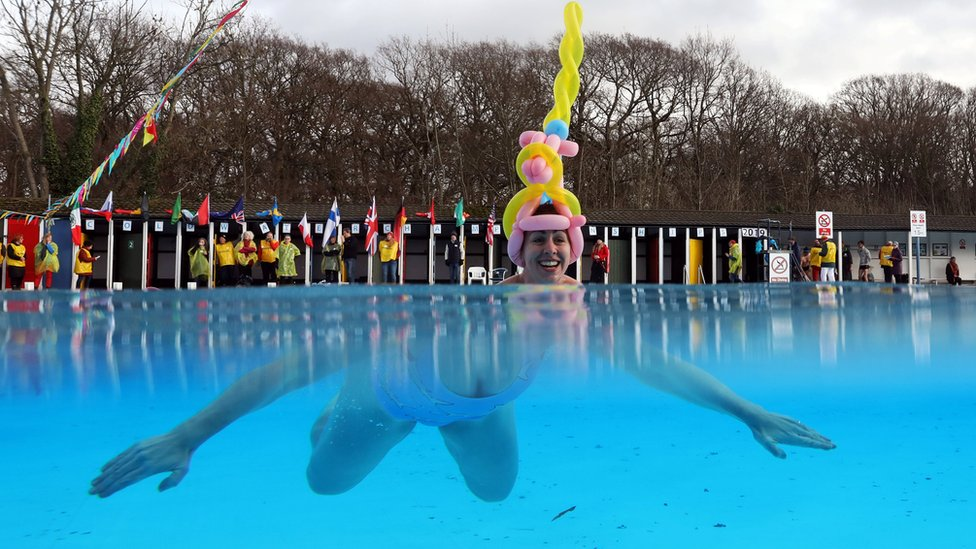 A woman participates in the Cold Water Swimming Championships at Tooting Bec Lido in south London