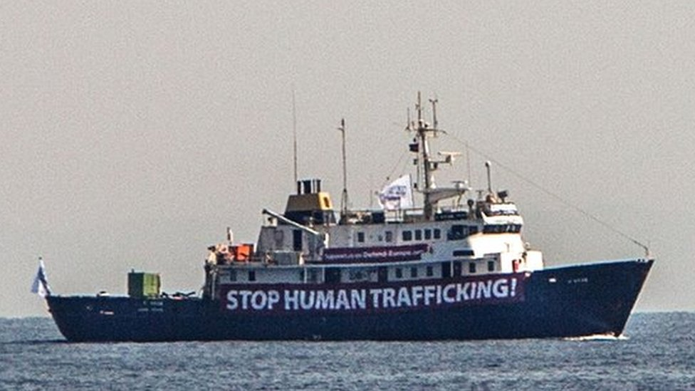 """A banner that reads, """"Stop Human Trafficking"""" is attached to the side of the C-Star as it sailed in the Mediterranean Sea"""
