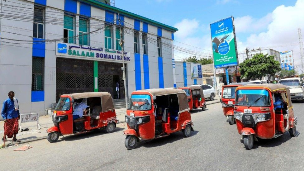 Rickshaw taxis drive past the Salaam Somali Bank in Wadajir district of Mogadishu, Somalia October 14, 2020.