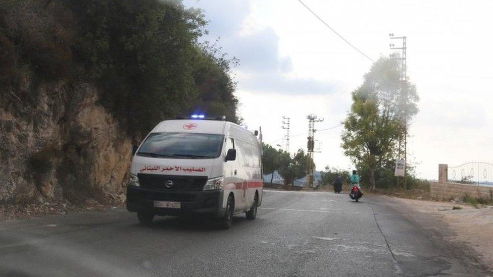 An ambulance drives through the village of Ain Qana, in Lebanon (22 September 2020)