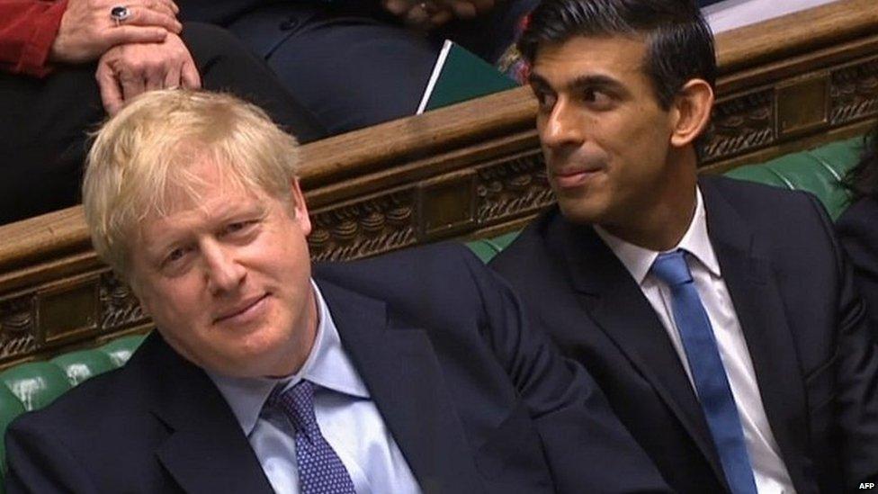 Boris Johnson and Rishi Sunak listening to the ex-chancellor's remarks