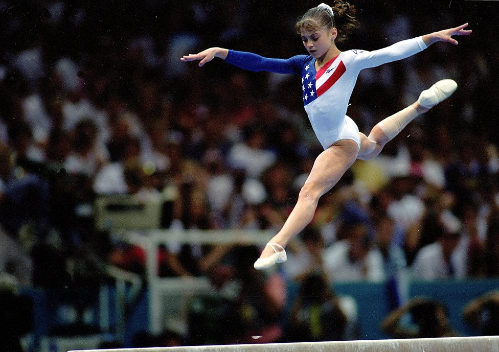 23 Jul 1996: Dominique Moceanu of the USA leaps during the Women's Beam event at the Georgia Dome in the 1996 Olympic Games in Atlanta, Georgia.