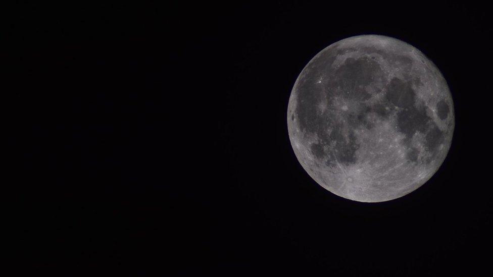 A still shot of the grey supermoon