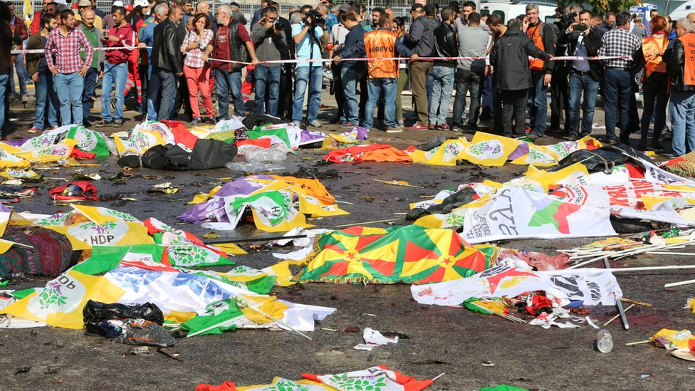 Bodies covered in flags after blasts in Ankara, Turkey, Saturday 10 October 2015