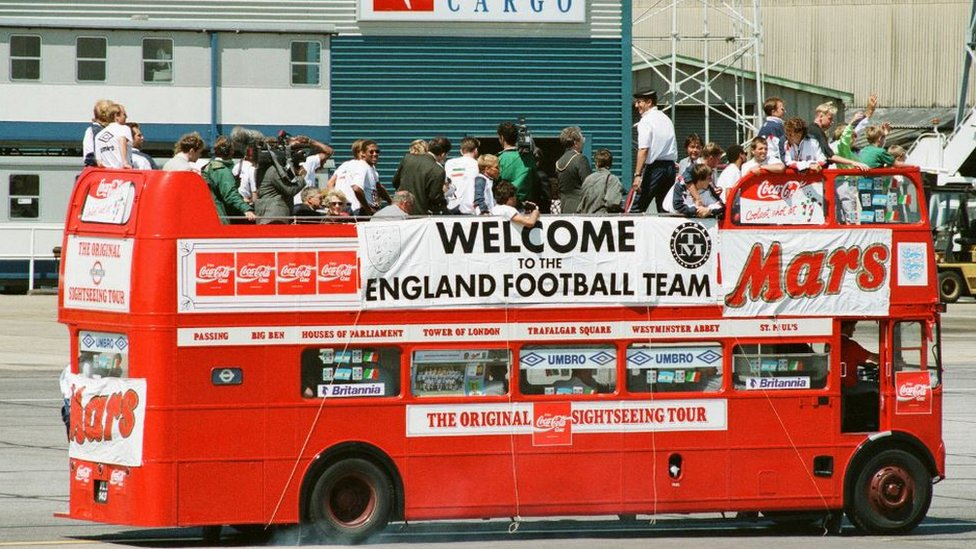 The England team in an open-top bus in Luton after the 1990 World Cup tournament