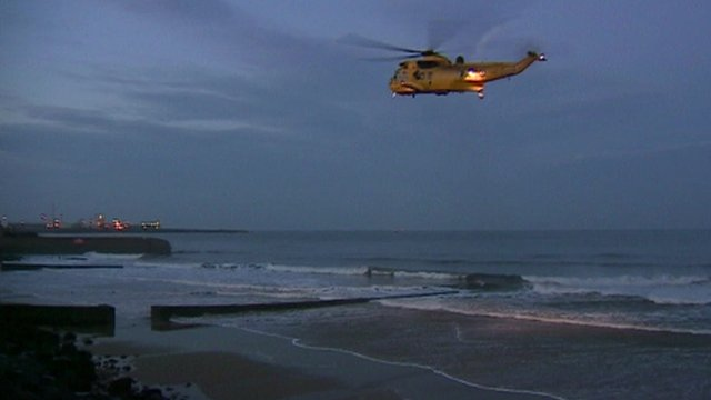 Search and rescue helicopter over beach