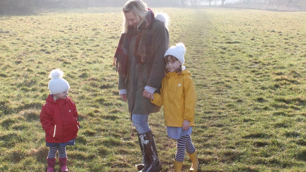 Molly Forbes with her children in a field
