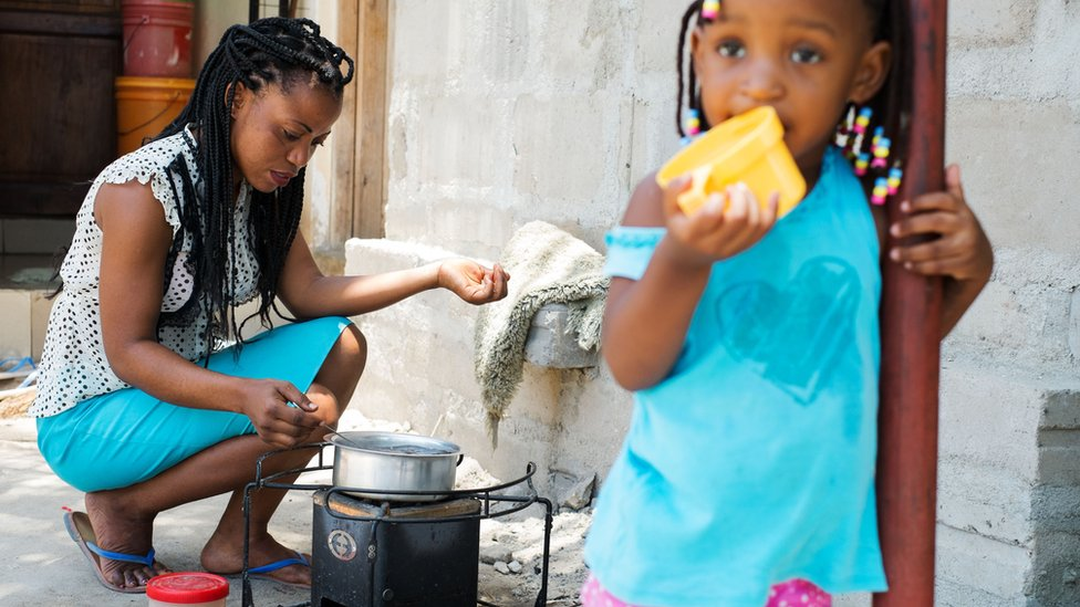 Esther Henry John prepares tea with environmentally friendly charcoal at her home in Dar es Salaam, Tanzania on March 10, 2015.