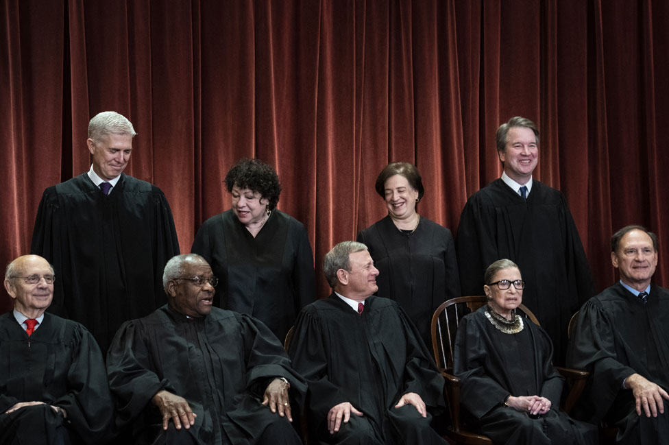 Seated from left, Stephen Breyer, Clarence Thomas, John Roberts, Ruth Bader Ginsburg and Samuel Alito, Jr. Standing from left, Neil Gorsuch, Sonia Sotomayor, Elena Kagan and Brett M Kavanaugh
