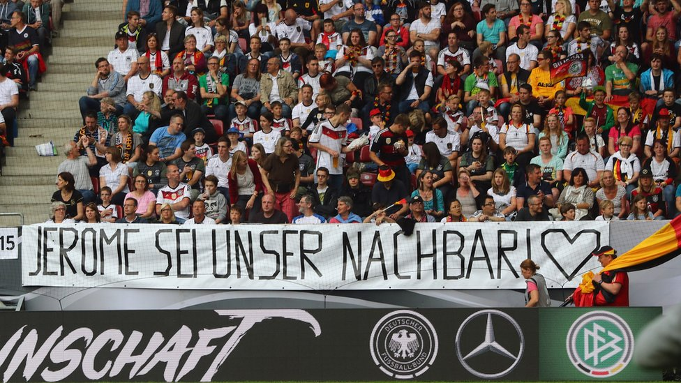 Fans of Germany present a banner to support Jerome Boateng