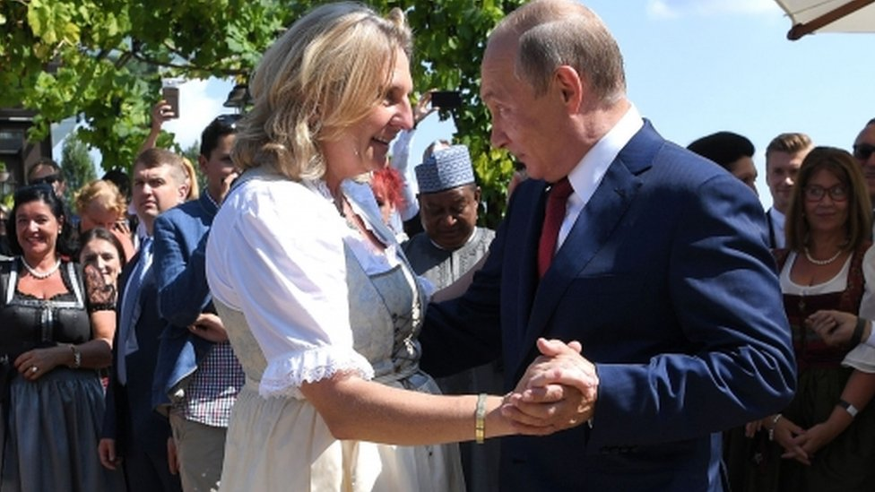 Austrian Foreign Minister Karin Kneissl and Russian President Vladimir Putin dance during her wedding on 18 August 2018 in Gamlitz, Austria